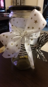 Ribbon, quote on top and gold stars inside...
